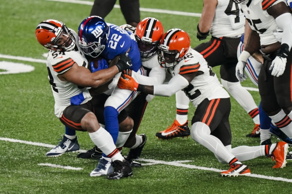 Cleveland Browns' Olivier Vernon (54) tackles New York Giants' Wayne Gallman (22) with teammates during the first half of an NFL football game Sunday,...