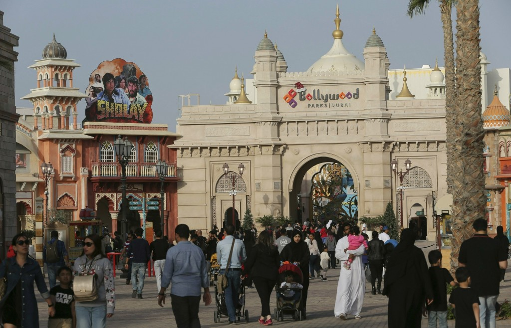 FILE - In this Dec. 18, 2016 file photo, people visit the Bollywood theme park at Dubai Parks & Resorts in Dubai, United Arab Emirates. The owner of D...