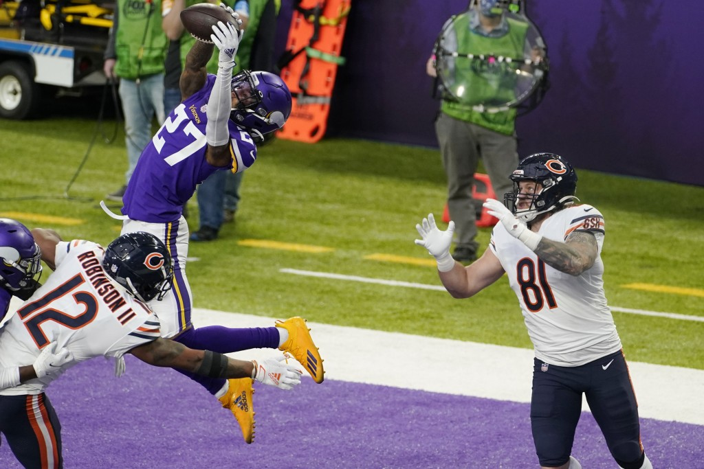 Minnesota Vikings cornerback Cameron Dantzler (27) intercepts a pass intended for Chicago Bears tight end J.P. Holtz (81) during the second half of an...