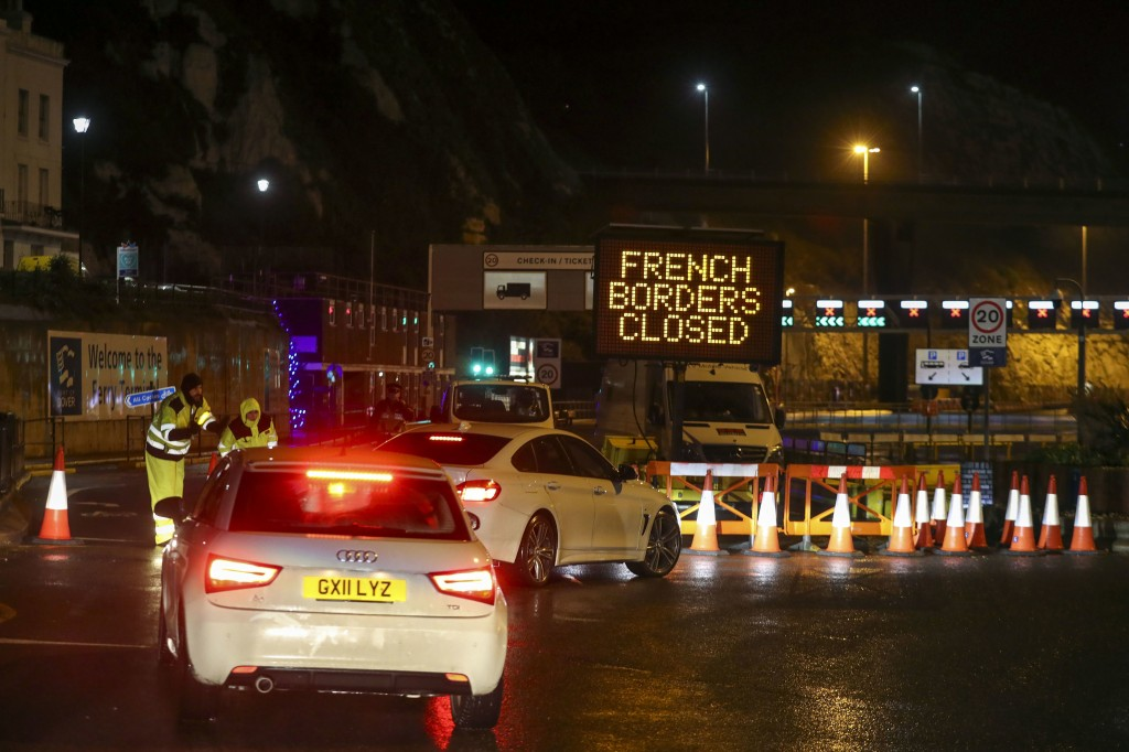 Police and port staff turn away vehicles from the Port of Dover in Kent, England which has been closed after the French government's announcement, Mon...