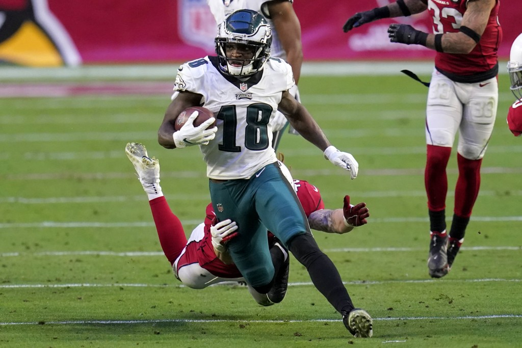 Philadelphia Eagles wide receiver Jalen Reagor (18) eludes the grasp of Arizona Cardinals linebacker Dennis Gardeck during the second half of an NFL f...