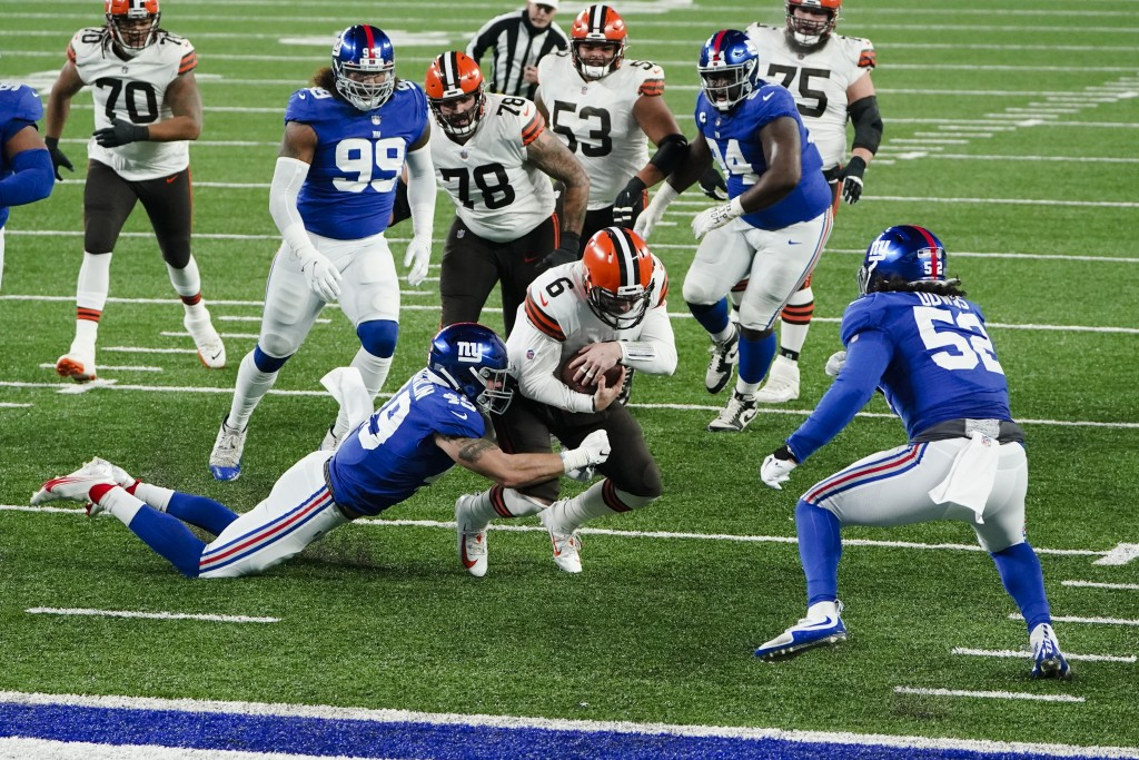 New York Giants linebacker Carter Coughlin (49) tackles Cleveland Browns quarterback Baker Mayfield (6) during the first half of an NFL football game,...