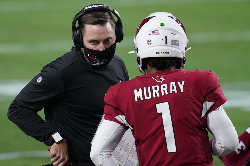 Arizona Cardinals head coach Kliff Kingsbury talks with quarterback Kyler Murray (1) during the second half of an NFL football game against the Philad...