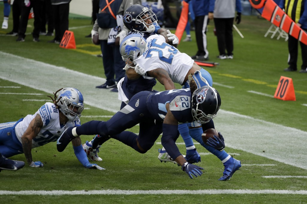 Tennessee Titans running back Derrick Henry scores against the Detroit Lions during the first half of an NFL football game Sunday, Dec. 20, 2020, in N...