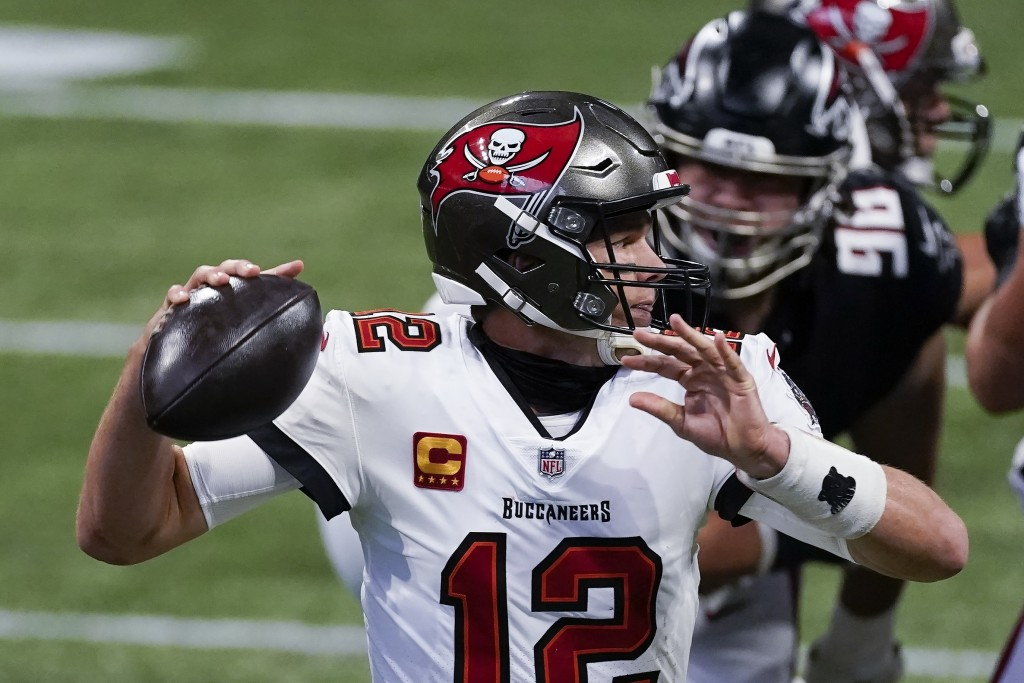 Tampa Bay Buccaneers quarterback Tom Brady (12) works in the pocket as Atlanta Falcons defensive tackle Tyeler Davison (96) gives pressure during the ...