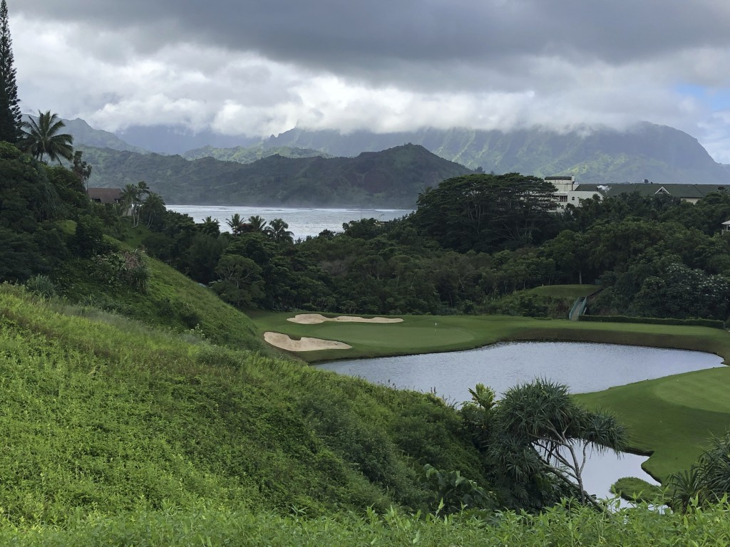 FILE - In this Nov. 16, 2018 file photo, clouds hang over a golf course near Kauai's Hanalei Bay in Princeville, Hawaii. The small, tight-knit communi...