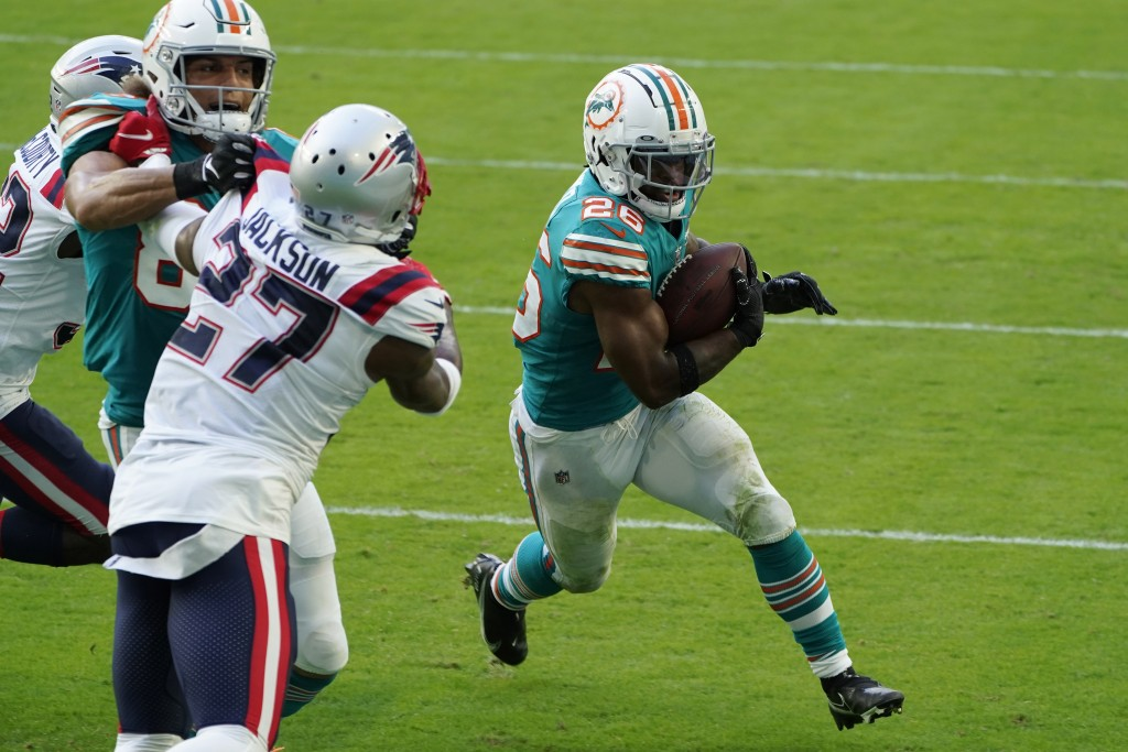 Miami Dolphins running back Salvon Ahmed (26) runs for a two-point conversion during the second half of an NFL football game against the New England P...