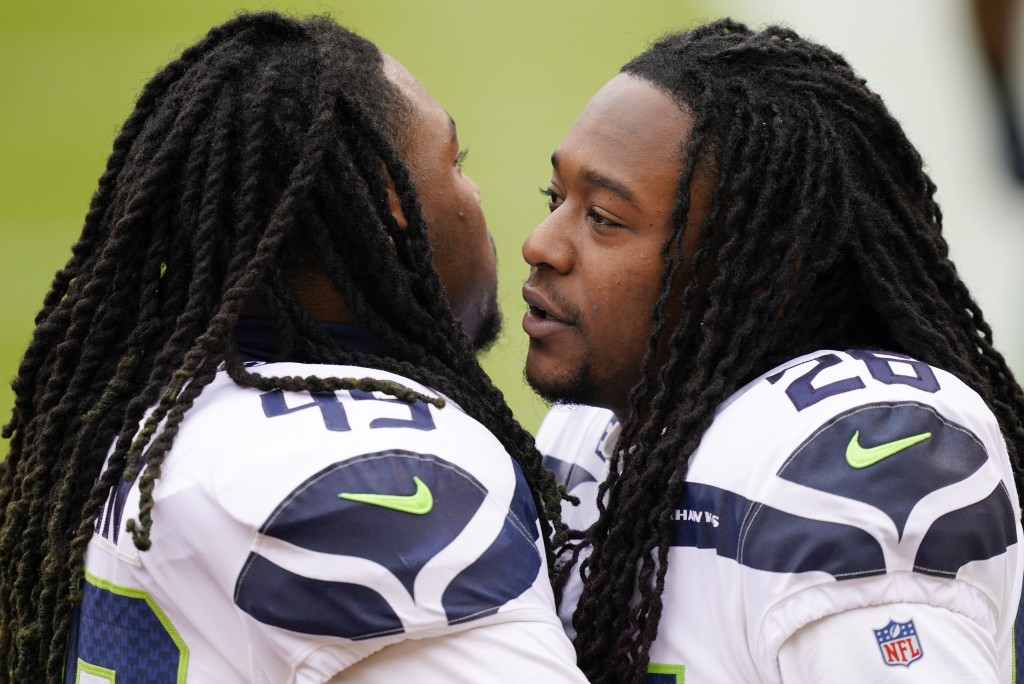 Seattle Seahawks outside linebacker Shaquem Griffin (49) and teammate cornerback Shaquill Griffin (26) greeting each other before the start of the fir...