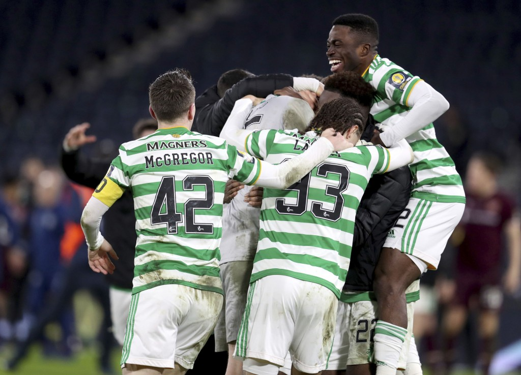Celtic celebrate winning after the Scottish Cup Final soccer match between Celtic and Heart of Midlothian at Hampden Park, Glasgow, Scotland, Sunday, ...