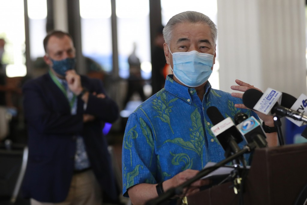 FILE - In this Oct. 15, 2020 file photo, Hawaii Gov. David Ige speaks at a news conference as Lt. Gov. Josh Green, left, looks on at the Daniel K. Ino...