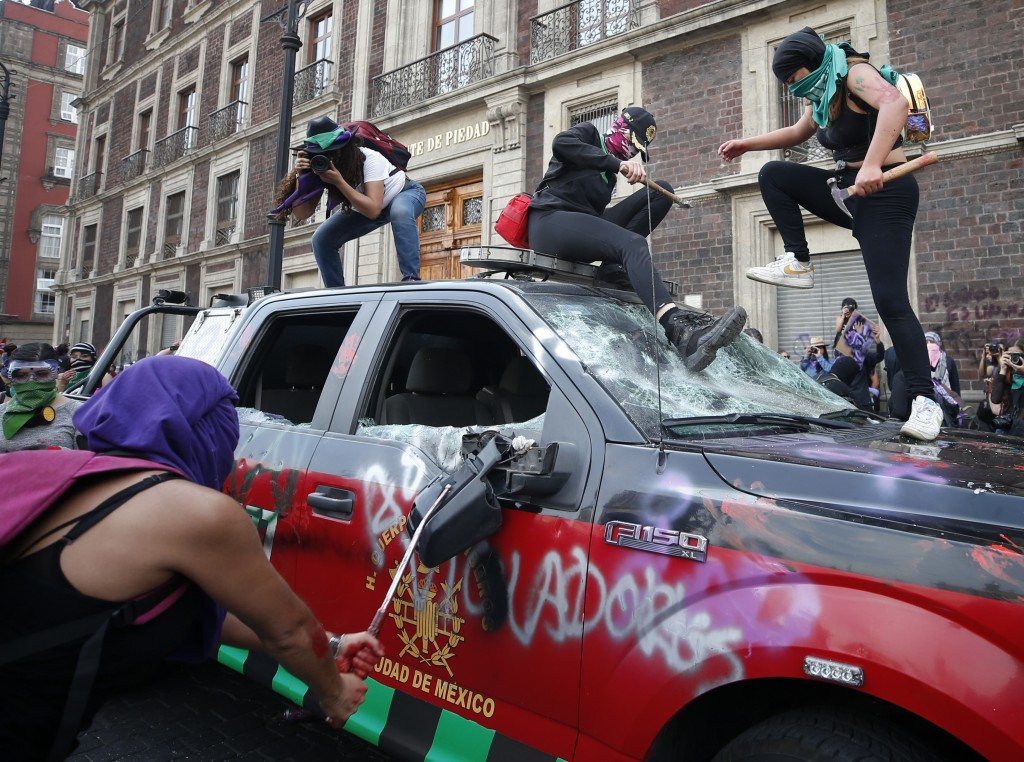 Demonstrators attack a fire department truck to protest gender violence during a march marking International Women's Day in Mexico City's main square,...