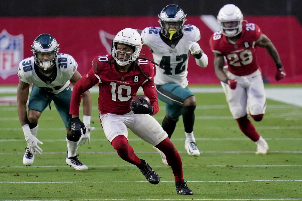 Arizona Cardinals wide receiver DeAndre Hopkins (10) runs after the catch as Philadelphia Eagles safety K'Von Wallace (42) pursues during the second h...