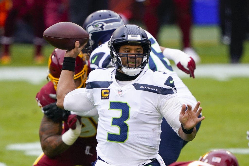 Seattle Seahawks quarterback Russell Wilson (3) passes the ball during the first half of an NFL football game against the Washington Football Team, Su...