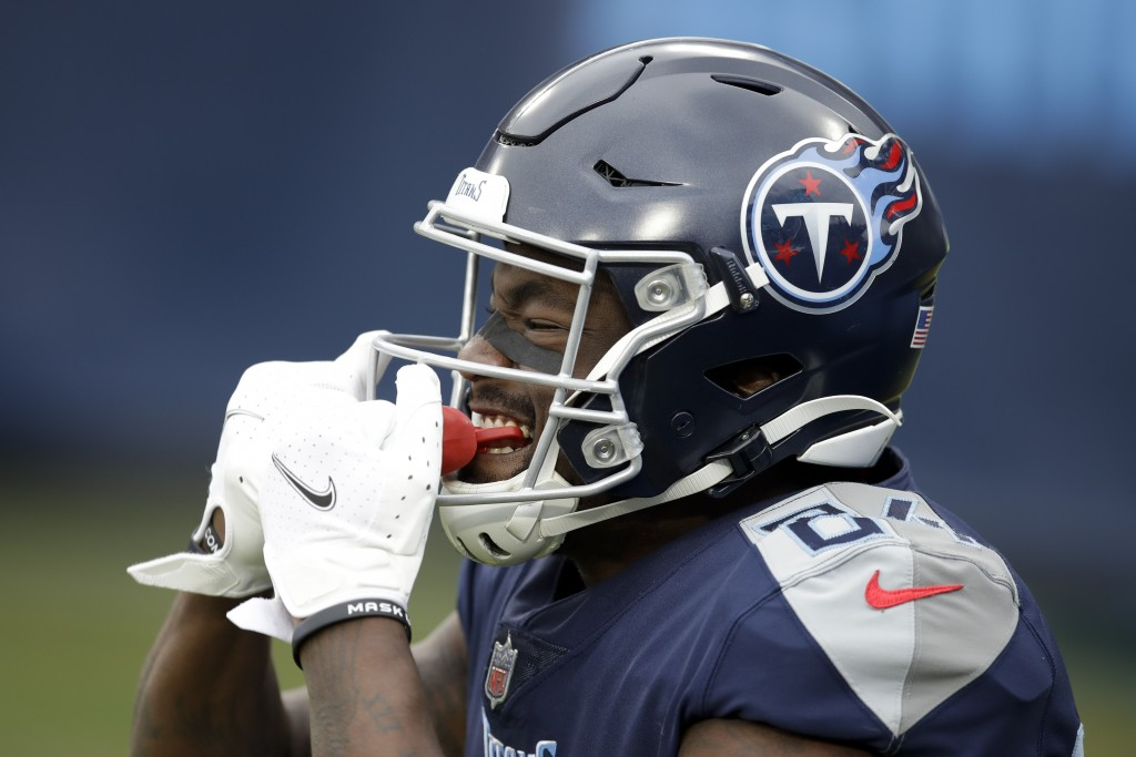 Tennessee Titans wide receiver Corey Davis celebrates after scoring against the Detroit Lions during the first half of an NFL football game Sunday, De...