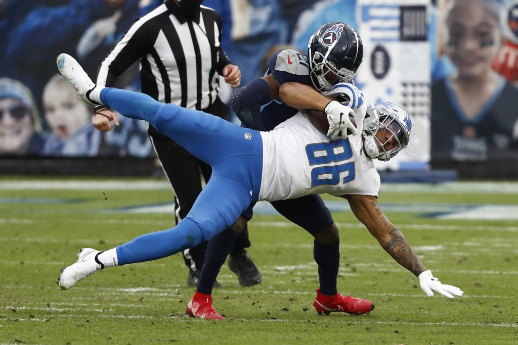 Detroit Lions tight end Hunter Bryant (86) is tackled by Tennessee Titans cornerback Malcolm Butler during the first half of an NFL football game Sund...