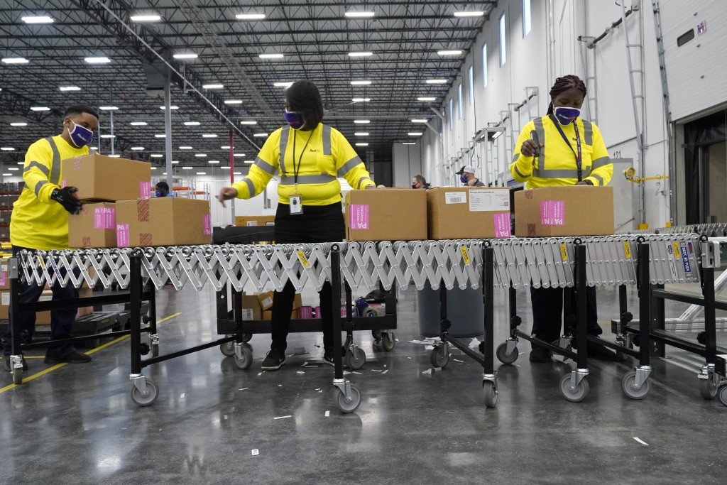 Boxes containing the Moderna COVID-19 vaccine are prepared to be shipped at the McKesson distribution center in Olive Branch, Miss., Sunday, Dec. 20, ...