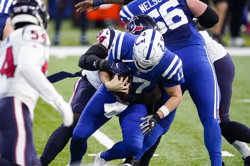 Houston Texans defensive end Charles Omenihu (94) sacks Indianapolis Colts quarterback Philip Rivers (17) in the first half of an NFL football game in...