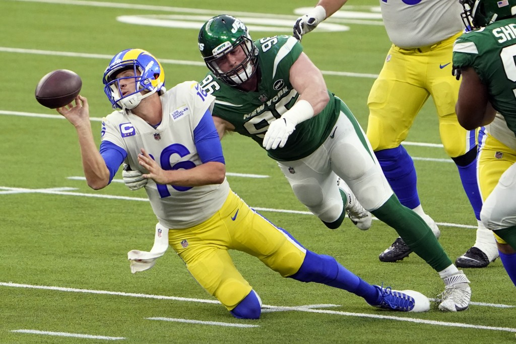 Los Angeles Rams quarterback Jared Goff throws the ball away as he is tackled by New York Jets defensive end Henry Anderson during the second half of ...