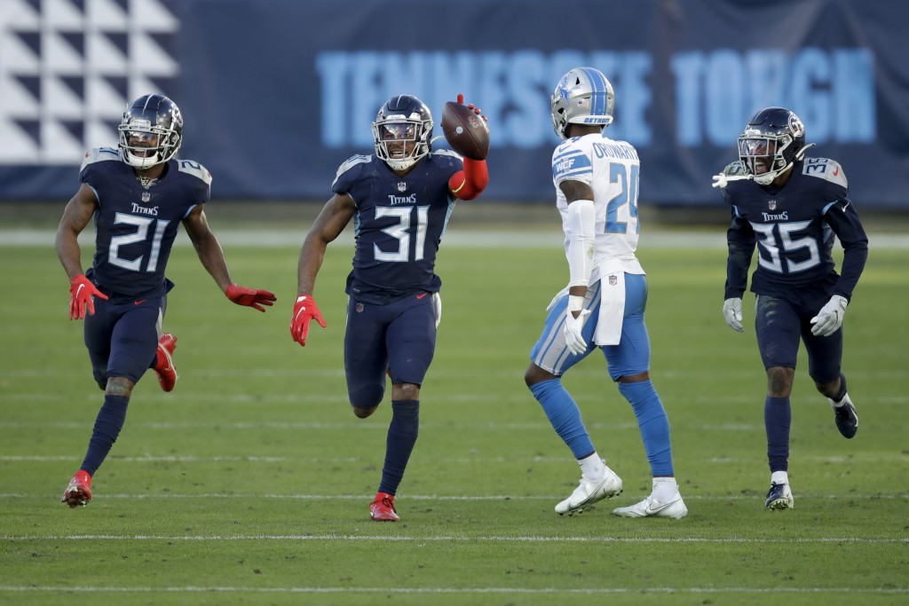 Tennessee Titans free safety Kevin Byard (31) celebrates after scoring against the Detroit Lions during the second half of an NFL football game Sunday...