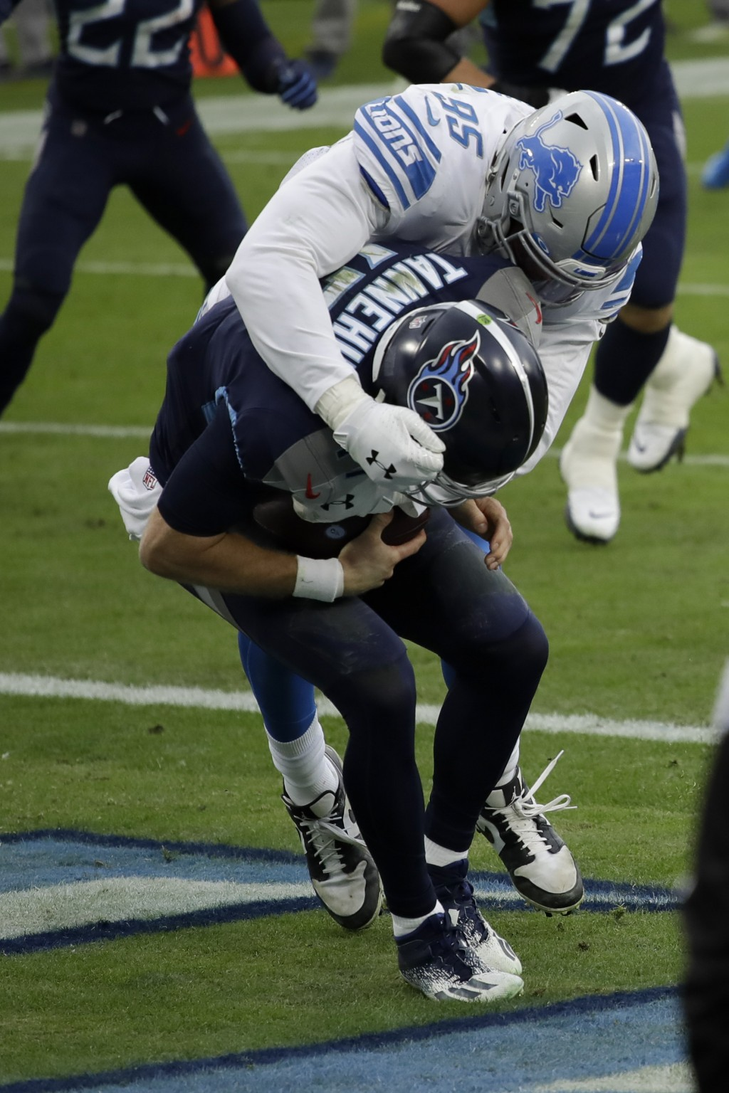 Detroit Lions defensive end Romeo Okwara sacks Tennessee Titans quarterback Ryan Tannehill for a safety during the first half of an NFL football game ...