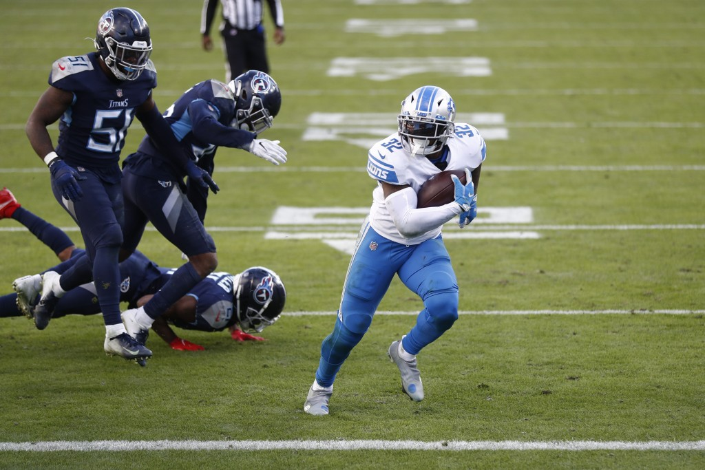 Detroit Lions running back D'Andre Swift score against the Tennessee Titans during the second half of an NFL football game Sunday, Dec. 20, 2020, in N...
