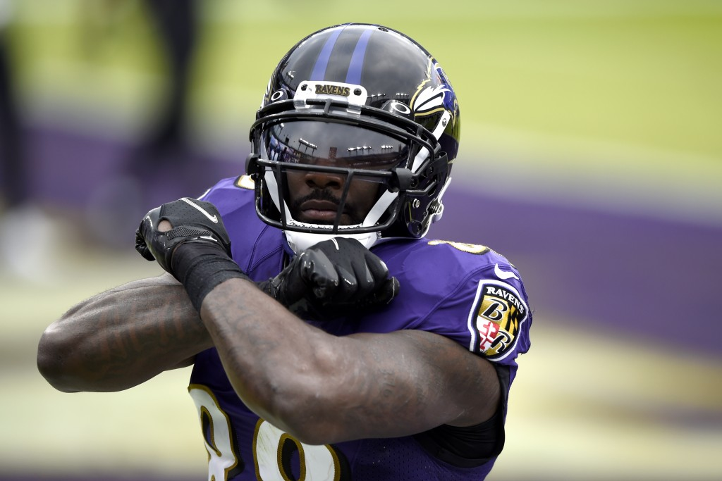 Baltimore Ravens wide receiver Dez Bryant reacts after catching a touchdown pass against the Jacksonville Jaguars during the first half of an NFL foot...
