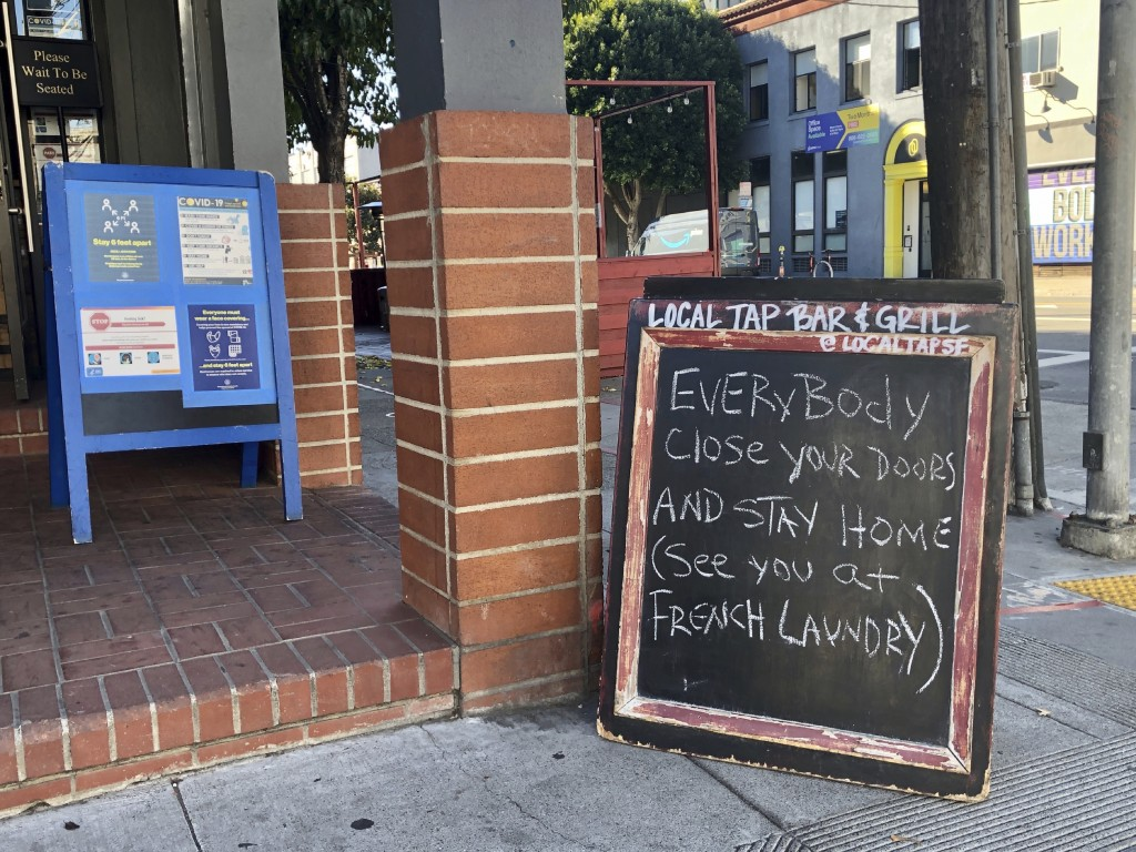 A sign calling out California Gov. Gavin Newsom for not following his own pandemic protocols at the French Laundry restaurant is seen in San Francisco...