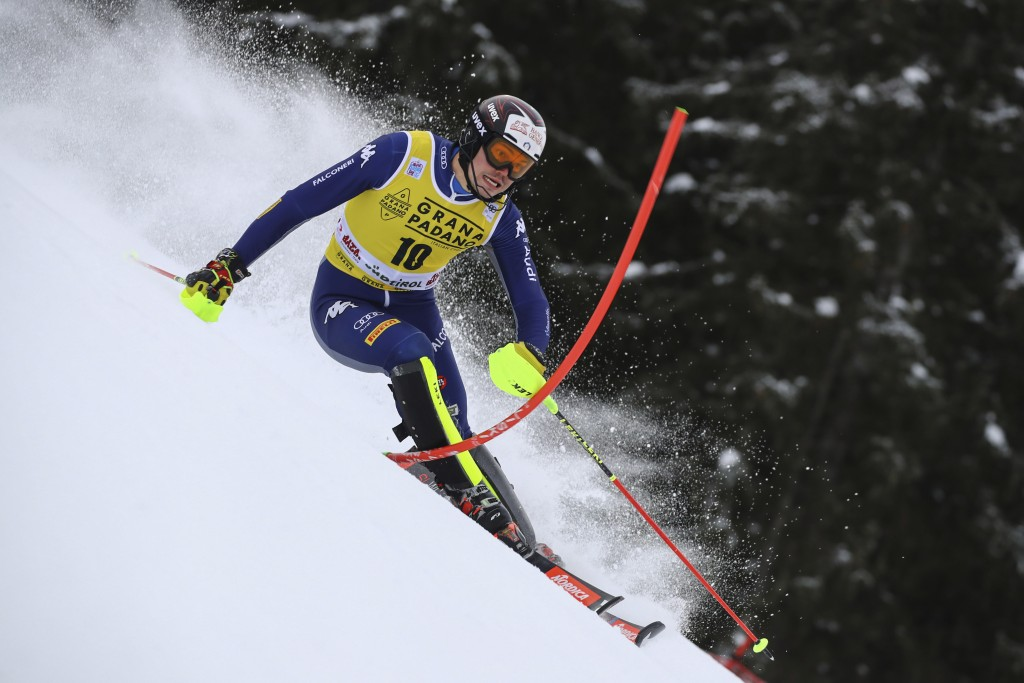 Italy's Alex Vinatzer speeds down the course during an alpine ski, men's World Cup slalom in Alta Badia, Italy, Monday, Dec.21, 2020. (AP Photo/Marco ...