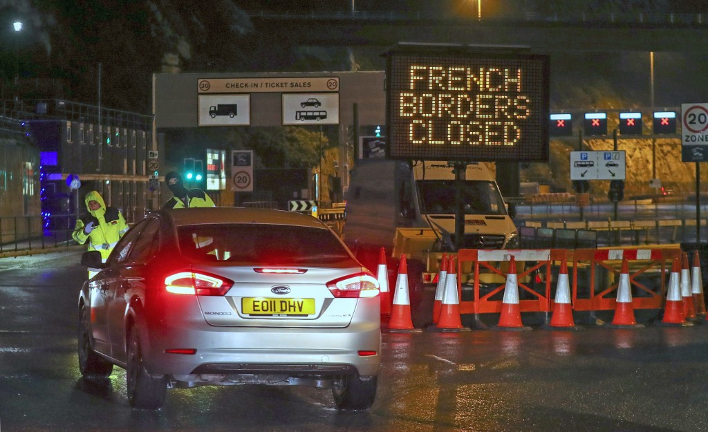 Police and port staff turn away a vehicle from the Port of Dover in Kent, England which has been closed after the French government's announcement, Mo...