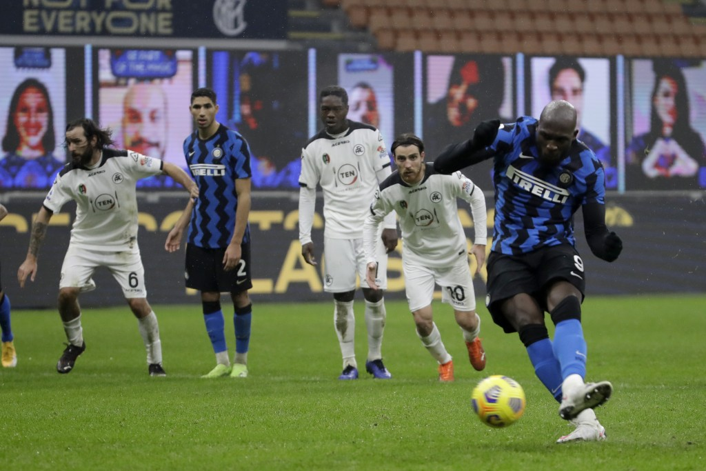 Inter Milan's Romelu Lukaku scores his side's 2nd goalform the penalty spot, during the Serie A soccer match between Inter Milan and Spezia, at the Sa...