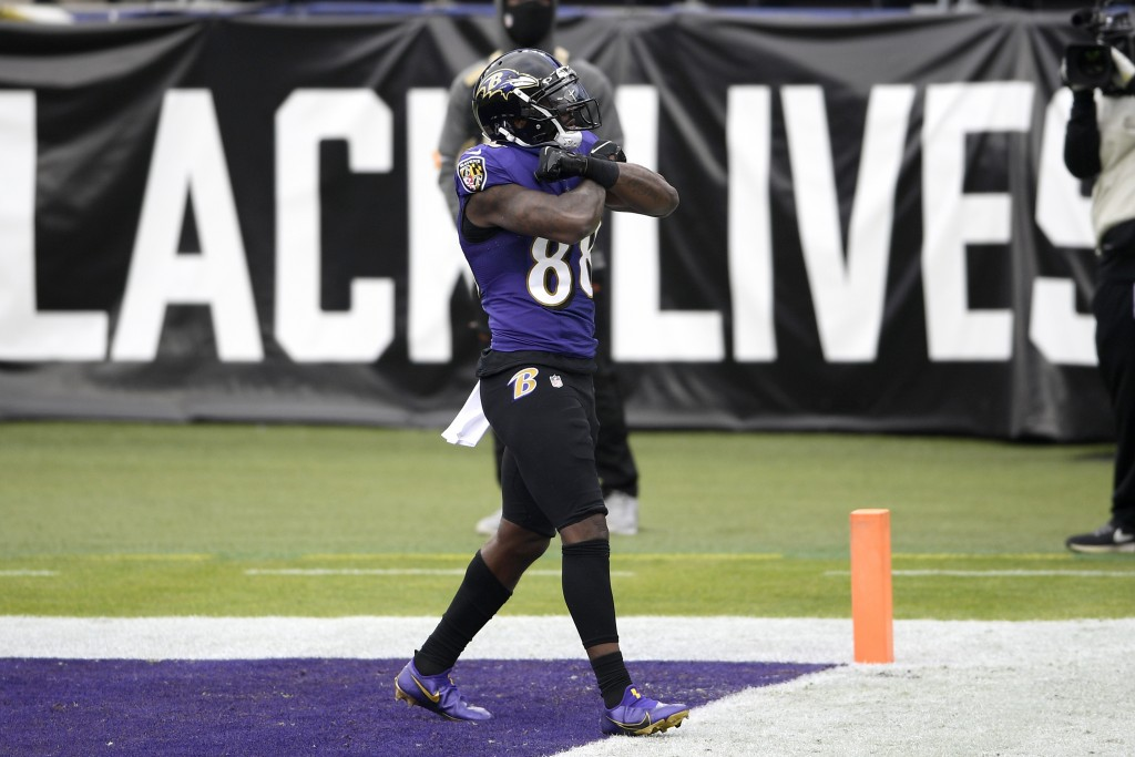 Baltimore Ravens wide receiver Dez Bryant reacts after scoring a touchdown against the Jacksonville Jaguars during the first half of an NFL football g...