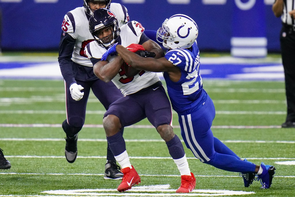 Houston Texans running back David Johnson (31) is tackled by Indianapolis Colts cornerback Xavier Rhodes (27) in the first half of an NFL football gam...