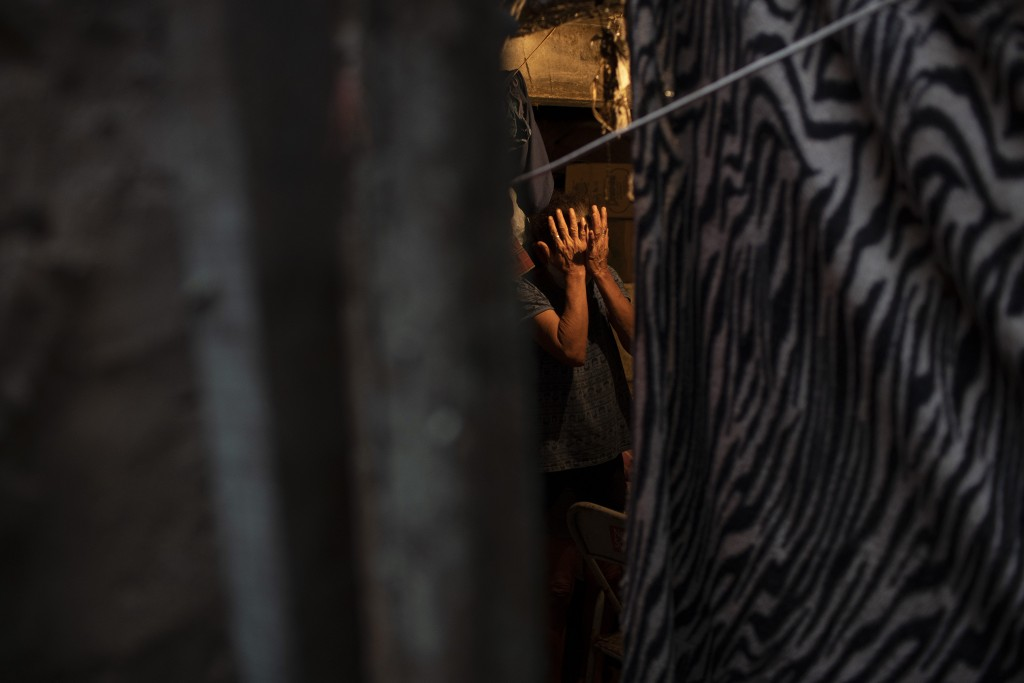 """Maria Rita Dias dos Santos wipes tears after former inmates delivered free food to her home, as part of a nonprofit organization known as """"Eu sou Eu"""" ..."""