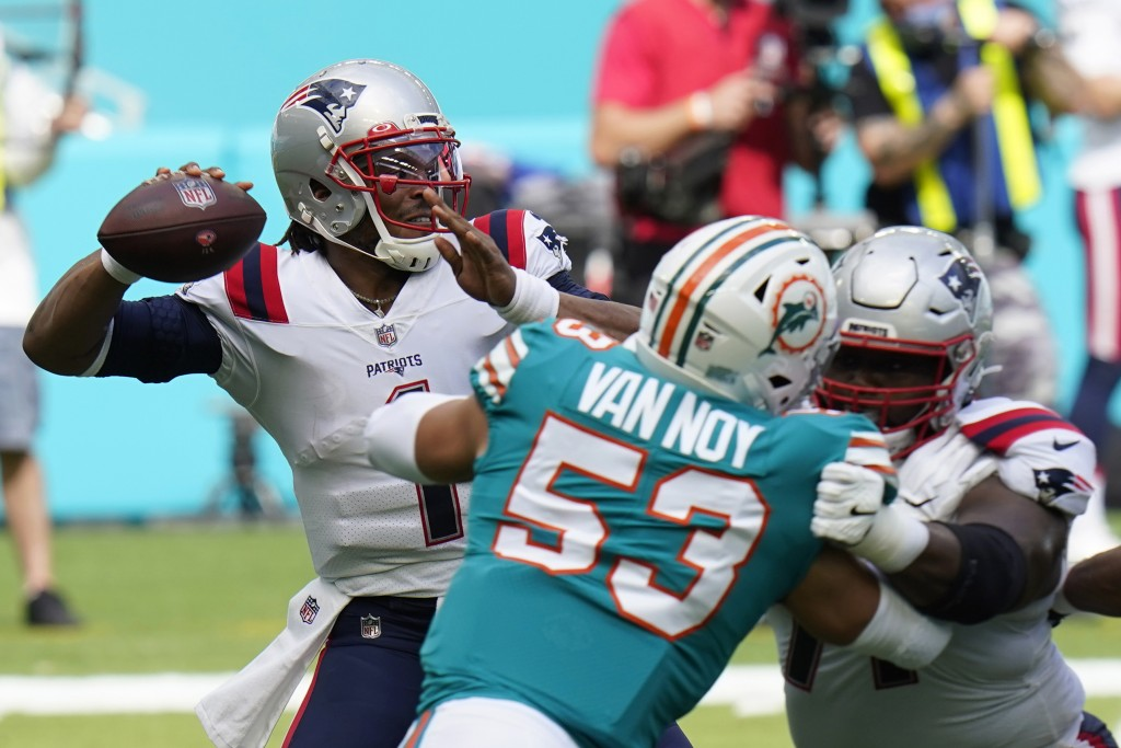 New England Patriots quarterback Cam Newton (1) looks to pass the football during the first half of an NFL football game against the Miami Dolphins, S...