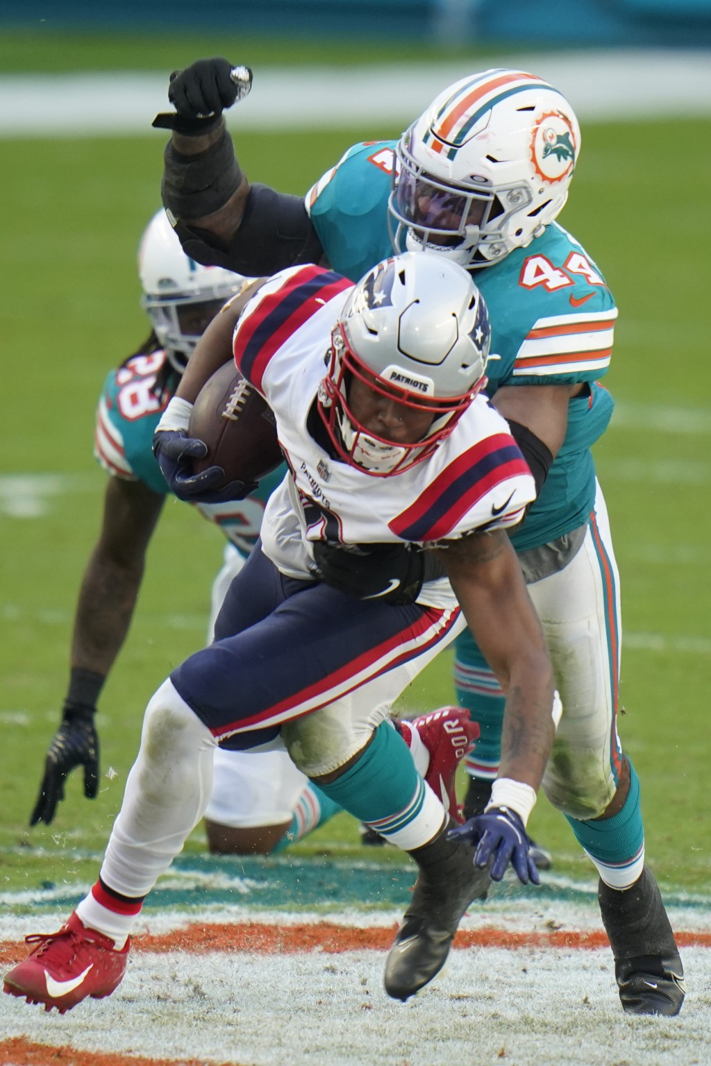 Miami Dolphins outside linebacker Elandon Roberts (44) tackles New England Patriots wide receiver Jakobi Meyers (16), during the second half of an NFL...