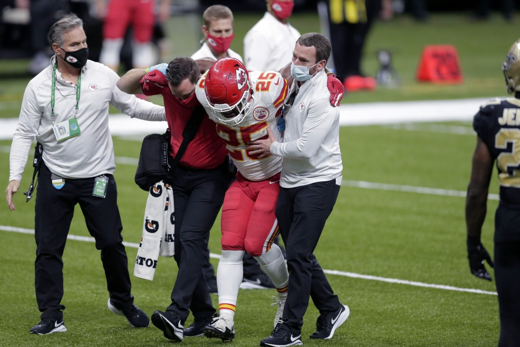 Kansas City Chiefs running back Clyde Edwards-Helaire (25) is helped off the field after being injured in the second half of an NFL football game agai...