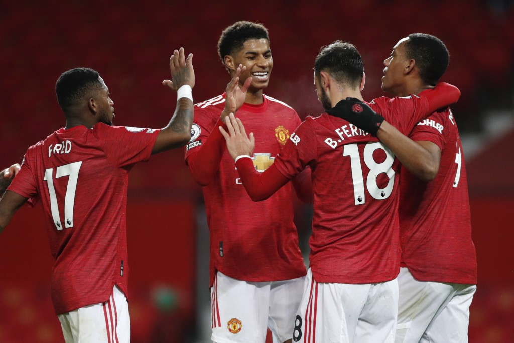 Manchester United's Bruno Fernandes, 2nd right, celebrates his side's sixth goal from a penalty kick with team mates during an English Premier League ...