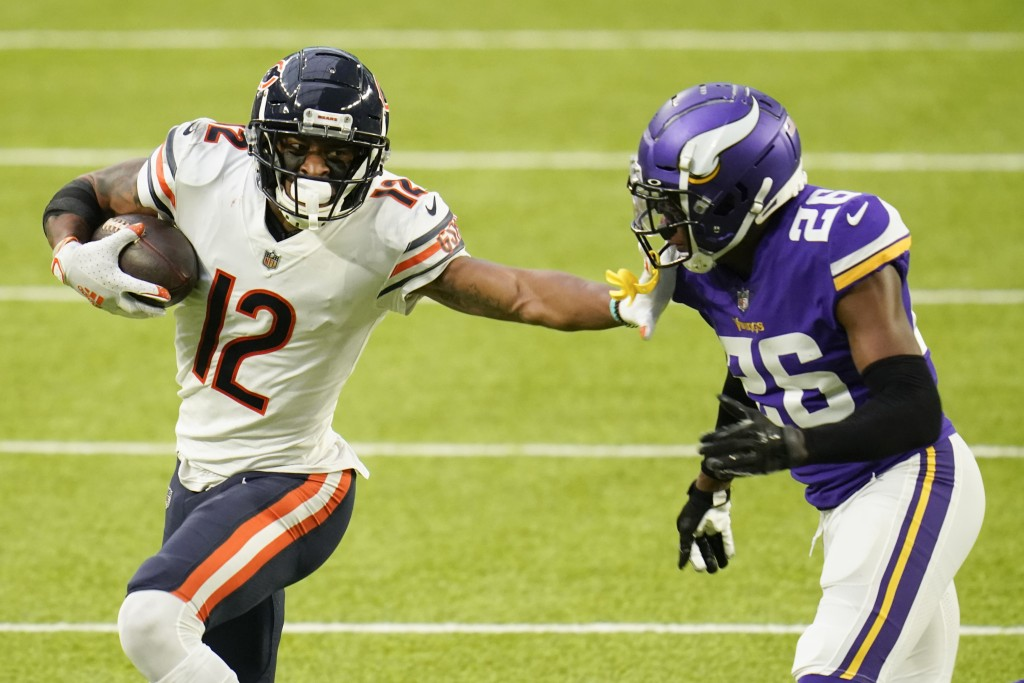 Chicago Bears wide receiver Allen Robinson II (12) runs from Minnesota Vikings cornerback Chris Jones (26) after catching a pass during the second hal...