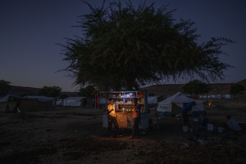 Tigrayan refugee men sell goods in their shack to make a living at Umm Rakouba refugee camp in Qadarif, eastern Sudan, Friday, Dec. 11, 2020. (AP Phot...