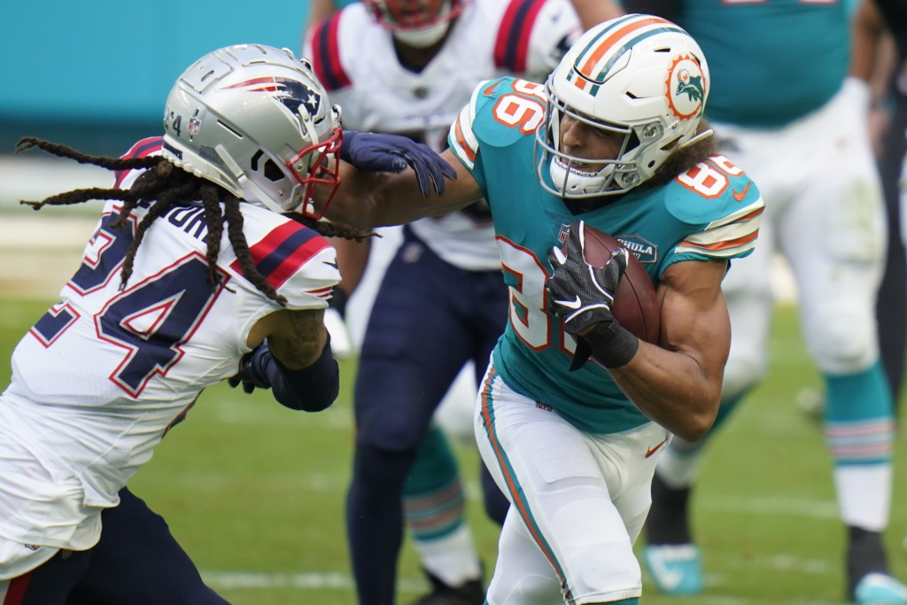 New England Patriots cornerback Stephon Gilmore (24) attempts to stop Miami Dolphins wide receiver Mack Hollins (86), during the first half of an NFL ...