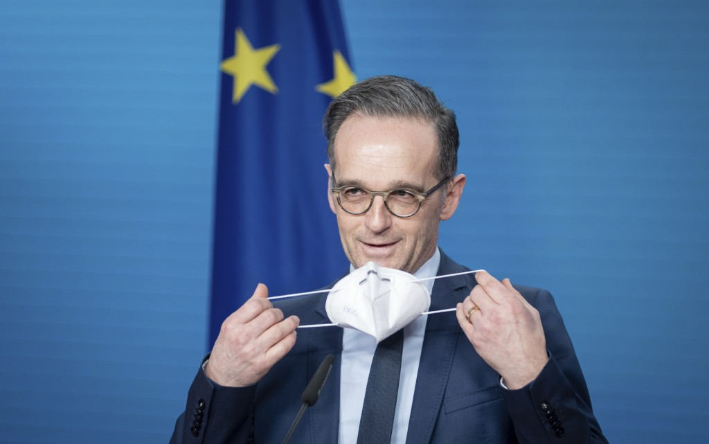 Heiko Maas, German Foreign Minister, puts on his mouth-nose protection at the end of the press conference on the informal virtual meeting of the forei...