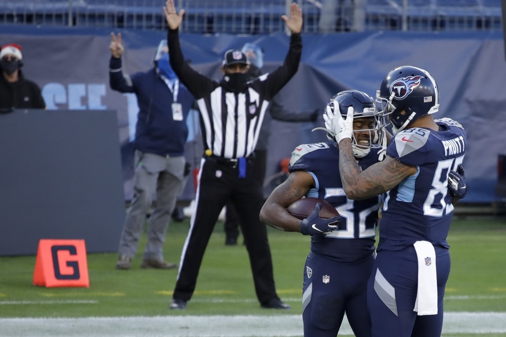 Tennessee Titans running back Darrynton Evans celebrates after scoring with tight end MyCole Pruitt during the second half of an NFL football game aga...