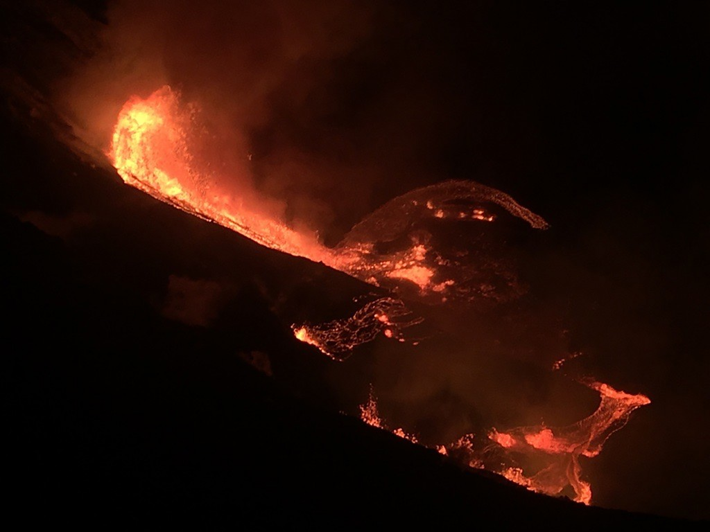In this photo provided by the U.S. Geological Survey, lava flows within the Halema'uma'u crater of the Kilauea volcano Sunday, Dec. 20, 2020. The Kila...
