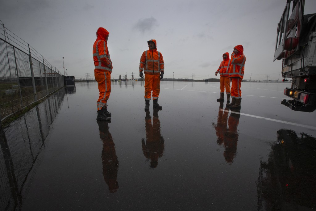 Workers finish preparations on an overflow parking lot for trucks after the Brexit transition period, in Hook of Holland, near Rotterdam, Netherlands,...