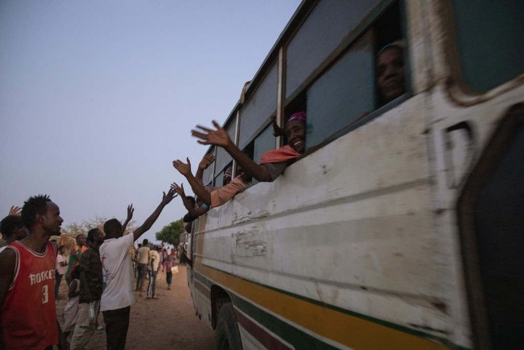 People who fled the conflict in Ethiopia's Tigray region, arrive on a bus at Umm Rakouba refugee camp in Qadarif, eastern Sudan, Thursday, Nov. 26, 20...