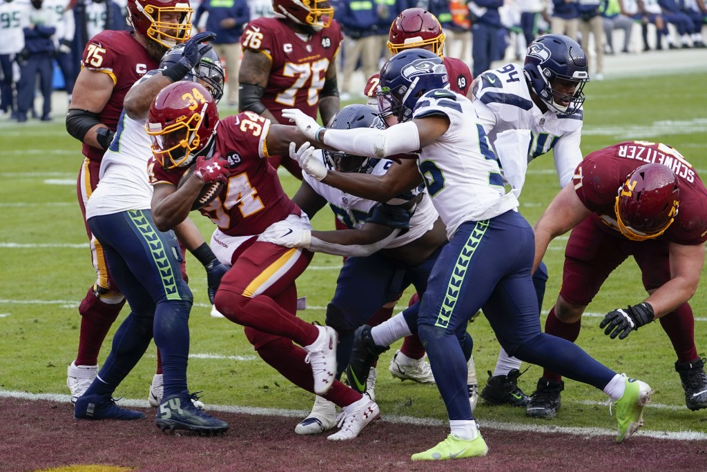 Washington Football Team running back Peyton Barber (34) runs past the Seattle Seahawks defense to score a touchdown during the second half of an NFL ...