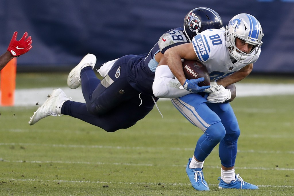 Detroit Lions wide receiver Danny Amendola is tackled by Tennessee Titans outside linebacker Harold Landry during the second half of an NFL football g...