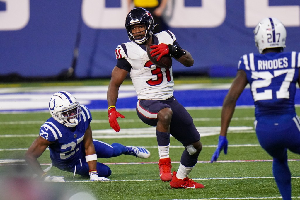 Houston Texans running back David Johnson (31) runs against the Indianapolis Colts in the second half of an NFL football game in Indianapolis, Sunday,...