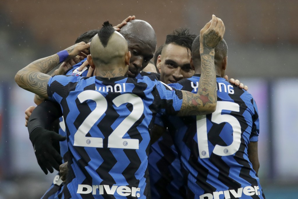 Inter Milan's Romelu Lukaku, center left, celebrates with teammates after scoring his side's 2nd goal during the Serie A soccer match between Inter Mi...
