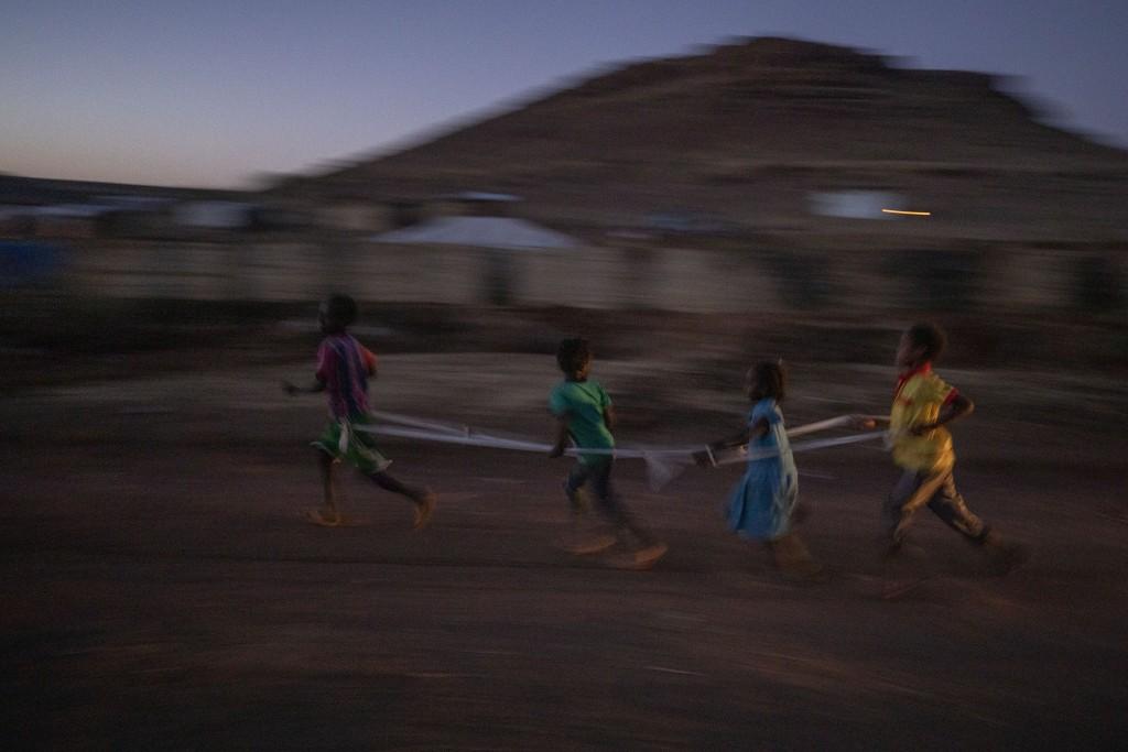 Tigrayan refugee children play with a rope at Umm Rakouba refugee camp in Qadarif, eastern Sudan, Friday, Dec. 11, 2020. (AP Photo/Nariman El-Mofty)